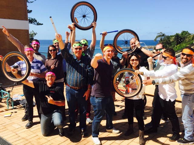 Chrsitmas teams building bikes for charity at conference in Terrigal Crowne Plaza