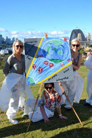 Corporate teams enjoy painting creative team building activities in Sydney in view of the Harbour Bridge