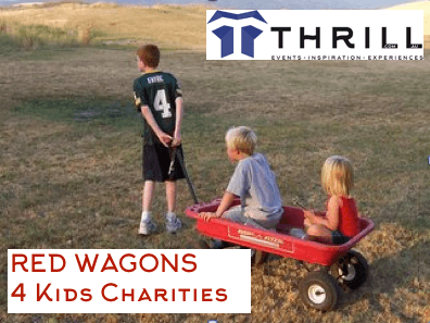 Corporate teams building red wagons for Christmas teambuilding helping Santa with kids charity hampers