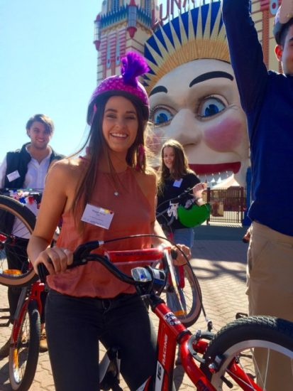 Winning smile of Westpac graduates team building bikes with Thrill at Luna Park North Sydney