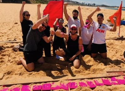Survivor team building on the beaches near Sydney and at Terrigal Beach playing a word puzzle to win immunity