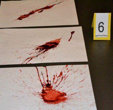 CSI team building activity scenario with blood splatter arrangements