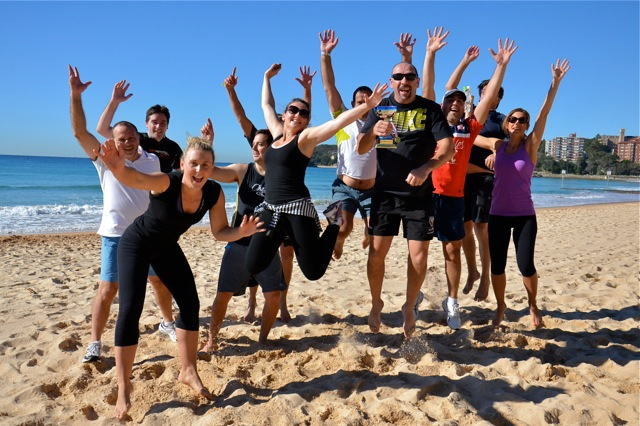 Manly corporate events team building activity fun games direct from Novotel Manly onto Beach Volleyball Court celebrating teamwork creatively