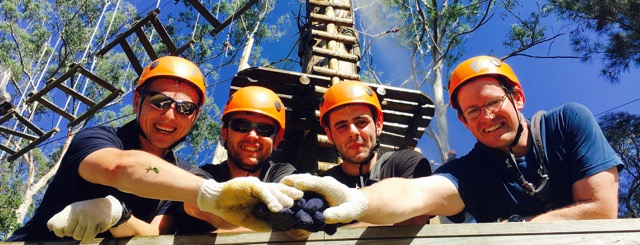 Sureteco team building training leaders on Sydney Trees Ropes Course with Thrill facilitators capturing the action