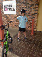 mission Australia kids receive team building bikes