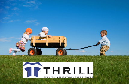 Kids fun pushing billy carts, racing along the grass for Thrill team building Charity giving CSR corporate activities
