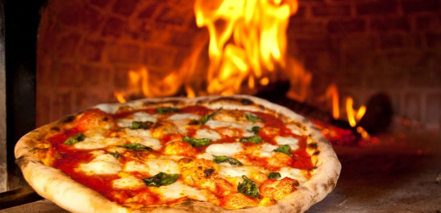 wood fired pizza cooking in sydney by Thrill hot pizza ovens for corporate groups
