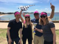 teams celebrating corporate chrsitams partsies on the beach in Sydney
