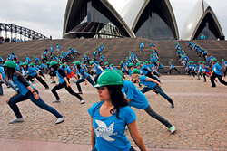 Flash Mob group performance at Sydney Opera House with Dancer performers setting the scene and creating a branding message that is inclusionary and a fantastic spectacle that encourages participation with amazing recognition